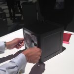 An HP employee demonstrates the tool-less chassis of the HP Proliant MicroServer Gen8